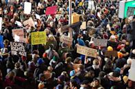 "<p>Protestors gather at New York City's JFK International Airport on Jan. 28, 2017, in support of newly banned refugees and visitors wishing to enter the country. </p> <p>On Jan. 27, 2017, <a href=""https://people.com/tag/donald-trump"" rel=""nofollow noopener"" target=""_blank"" data-ylk=""slk:President Donald Trump"" class=""link rapid-noclick-resp"">President Donald Trump</a> signed an executive order that t<a href=""https://people.com/politics/donald-trumps-new-travel-ban-6-muslim-majority-nations/"" rel=""nofollow noopener"" target=""_blank"" data-ylk=""slk:emporarily banned any refugees from entering the U.S."" class=""link rapid-noclick-resp"">emporarily banned any refugees from entering the U.S.</a>, indefinitely banned refugees who hail from Syria and temporarily banned citizens from several Muslim countries from entering the U.S. The order also required a ""religious test"" of sorts for refugees attempting to enter the U.S., giving preferential treatment to Christian and other religious minorities who live in Muslim countries over Muslims. The order, called the ""Muslim ban"" by Trump's critics, outraged many and caused bottlenecks at major U.S. airports as stranded travelers filed for emergency appeals. The ACLU and others have fought the order in court since it was first introduced, though in 2018, the Supreme Court upheld a third version of the ban signed by Trump.</p>"