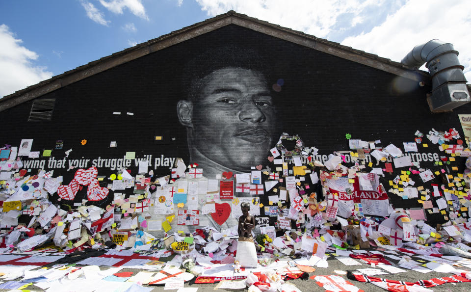 MANCHESTER, ENGLAND - JULY 15: Tributes are layn outside of a mural of Manchester United and England striker Marcus Rashford after it was recently defaced in the fallout of England's European Championship final defeat on Jul 15, 2021, in Manchester, England.  (Photo by Craig foy/SNS Group via Getty Images)