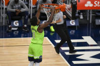 Minnesota Timberwolves guard Anthony Edwards dunks against the Portland Trail Blazers during the first half of an NBA basketball game Saturday, March 13, 2021, in Minneapolis. (AP Photo/Craig Lassig)