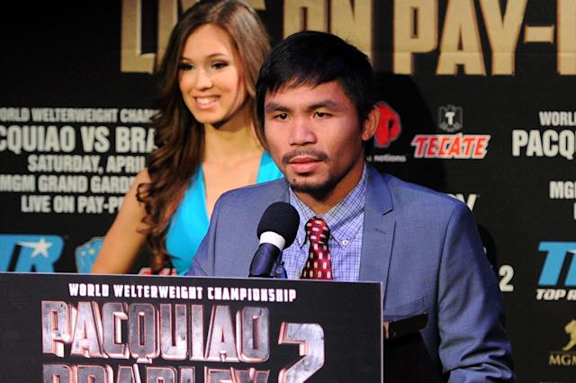 NEW YORK, NY - FEBRUARY 06: Manny Pacquiao addresses the media during the press conference to promote his upcoming WBO welterweight championship rematch fight against Timothy Bradley at New World Stages on February 6, 2014 in New York City. (Photo by Maddie Meyer/Getty Images)