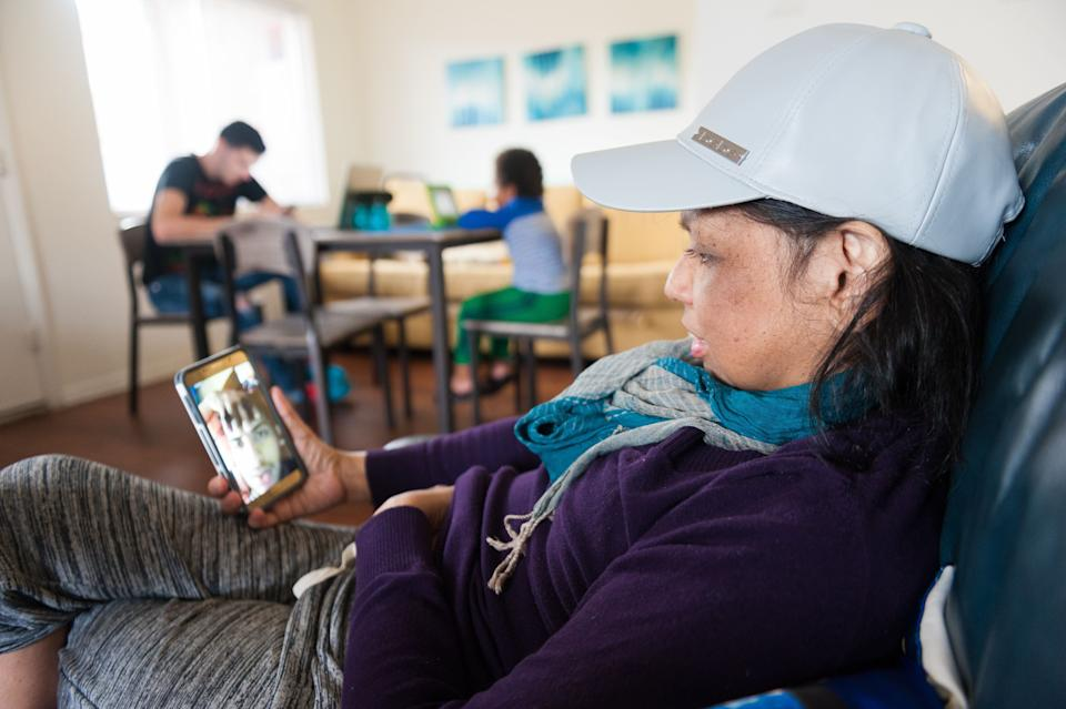 Mariluz talks on video chat with her son Jeancarlo. (Photo: Chris McGonigal/HuffPost)