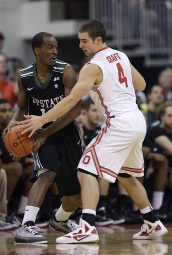 South Carolina Upstate's Adrian Rodger, left, looks for an open pass as Ohio State's Aaron Craft defends during the second half of an NCAA college basketball game Wednesday, Dec. 14, 2011, in Columbus, Ohio. Ohio State beat South Carolina Upstate 82-58. (AP Photo/Jay LaPrete)