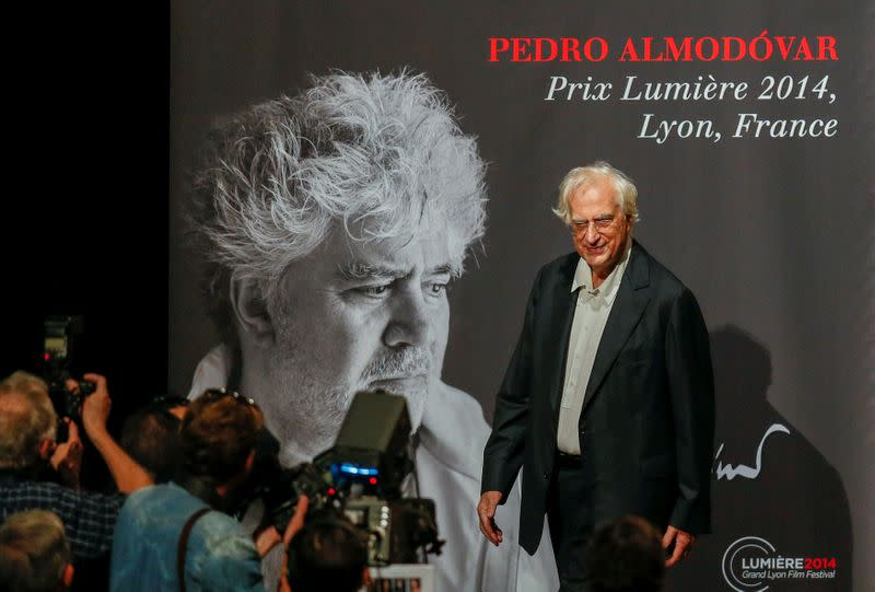 FILE PHOTO: Director Tavernier poses for photographers as he arrives at the 2014 Lumiere Film Festival prize in Lyon