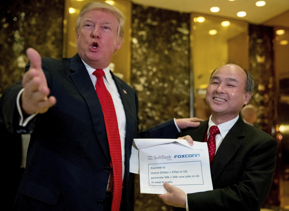 President-elect Donald Trump, left, accompanied by SoftBank CEO Masayoshi Son, speaks to members of the media at Trump Tower in New York. (AP Photo/Andrew Harnik, File)