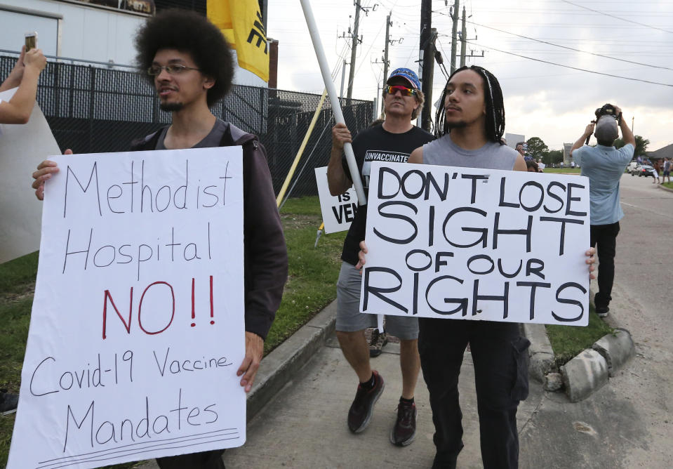 FILE - In this June 7, 2021, file photo, people march past Houston Methodist Baytown Hospital in Baytown, Texas, to protest against a policy that says hospital employees must get vaccinated against COVID-19 or lose their jobs. A federal judge dismissed their lawsuit, saying if workers don't like the rule, they can go find another job. (Yi-Chin Lee/Houston Chronicle via AP, FIle)
