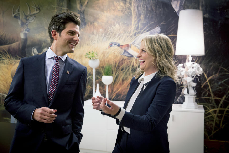 """PARKS AND RECREATION -- """"One Last Ride"""" Episode 712/713 -- Pictured: (l-r) Adam Scott as Ben Wyatt, Amy Poehler as Leslie Knope -- (Photo by: Paul Drinkwater/NBCU Photo Bank/NBCUniversal via Getty Images via Getty Images)"""