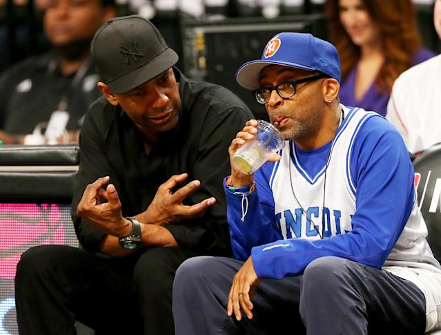 NEW YORK, NY - MAY 12: Denzel Washington and Spike Lee attend Game Four of the Eastern Conference Semifinals during the 2014 NBA Playoffs at the Barclays Center on May 12, 2014 in the Brooklyn borough of New York City. NOTE TO USER: User expressly acknowledges and agrees that, by downloading and/or using this photograph, user is consenting to the terms and conditions of the Getty Images License Agreement. (Photo by Elsa/Getty Images)