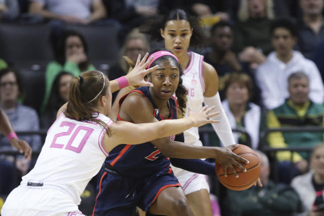 Arizona Oregon's Sabrina Ionescu, left, and Satou Sabally pressure Arizona's Aari McDonald during the second quarter of an NCAA college basketball game in Eugene, Ore., Friday, Feb. 7, 2020. (AP Photo/Chris Pietsch)