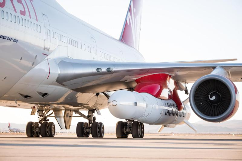 Air lift: the LauncherOne rocket is attached to the left wing of a Boeing 747: Virgin Orbit