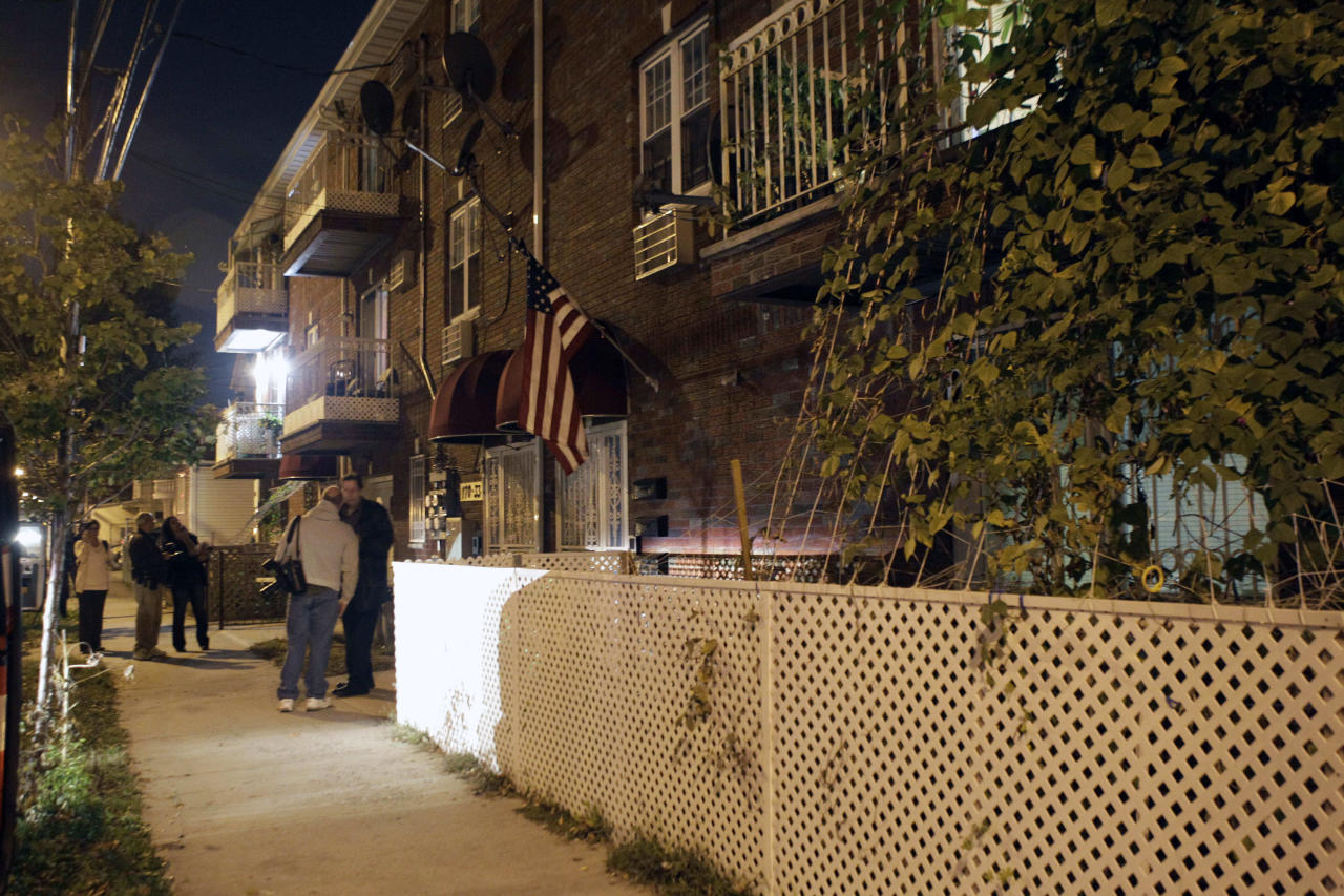 Spectators and journalists gather outside the residence of Quazi Mohammed Rezwanul Ahsan Nafis, the alleged Federal Reserve plot suspect who was arrested after attempting to blow up a fake car bomb outside the Federal Reserve building in Manhattan, on Wednesday, Oct. 17, 2012 in New York. Authorities say Nafis, a Bangladeshi man came to the United States to wage jihad, but was arrested in an elaborate FBI sting Wednesday in New York. (AP Photo/Kathy Willens)