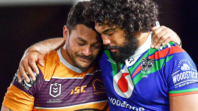 Brisbane Broncos captain Alex Glenn is pictured being consoled after the game by a New Zealand Warriors opponent.