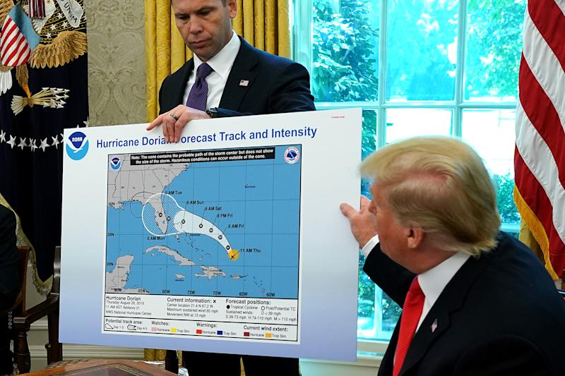 President Trump references a map held by acting Homeland Security Secretary Kevin McAleenan while talking to reporters following a briefing from officials about Hurricane Dorian. (Photo: Chip Somodevilla/Getty Images)