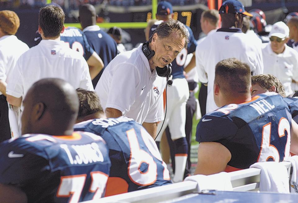 Denver Broncos offensive line coach Alex Gibbs talks to his line during a game in 2000. (Photo By John Leyba/The Denver Post via Getty Images)