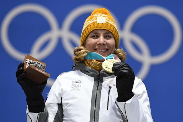 <p>Slovakia's gold medallist Anastasiya Kuzmina poses on the podium during the medal ceremony for the biathlon women's 12,5km mass start at the Pyeongchang Medals Plaza during the Pyeongchang 2018 Winter Olympic Games in Pyeongchang. (Getty) </p>