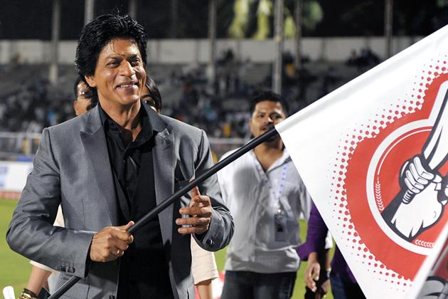 Indian Bollywood film actor Shah Rukh Khan flags the grand opening ceremony of the Toyota University Cricket Championship (TUCC) first match of the season in Mumbai on February 23, 2013.  AFP PHOTO        (Photo credit should read STR/AFP/Getty Images)