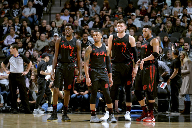MVP candidate Damian Lillard (second from left) will need some help from the likes of Al-Farouq Aminu (left), Jusuf Nurkic (third from left) and Evan Turner for Portland to make a deep postseason run. (Getty)