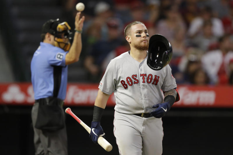 Boston Red Sox's Christian Vazquez tosses his hemet after striking out against the Los Angeles Angels during the second inning of a baseball game in Anaheim, Calif., Saturday, Aug. 31, 2019. (AP Photo/Chris Carlson)