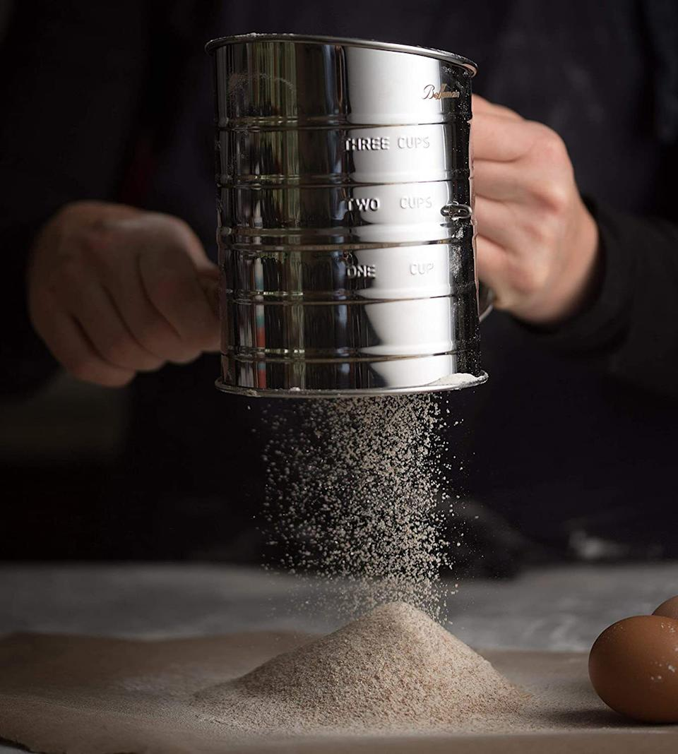 """This is great for anyone who is tired of using one with a squeeze handle — this crank model will make your baking efforts a breeze.<br /><br /><strong>Promising review:</strong>""""Great sifter!<strong>This design is so much better than the squeeze variety I have been using, my hand was SO tired from my old sifter.</strong>This is just like my grandma used to have, seems solid. I expect to have many years of service from it. Sifting the flour makes a 100% difference in gluten-free baking, especially with those heavy bean flours. I know some people are talking about not being able to wash their sifters, but you know, I remember my grandma keeping hers in her big tip-out flour bin all the time without a problem. I'm keeping mine in a plastic bag as recommended by the manufacturer. I think it is a great product and a great buy."""" —<a href=""""https://amzn.to/3et56kq"""" target=""""_blank"""" rel=""""noopener noreferrer"""">Doonsie<br /></a><br /><strong>Get it from Amazon for<a href=""""https://amzn.to/2QsIuZB"""" target=""""_blank"""" rel=""""noopener noreferrer"""">$10.50</a>.</strong>"""