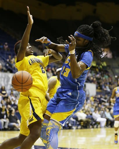 UCLA guard Markel Walker, right, is stopped while going to the basket by California guard Afure Jemerigbe, left, during the first half of their NCAA college basketball game on Sunday, Jan. 20, 2013, in Berkeley, Calif. (AP Photo/Eric Risberg)