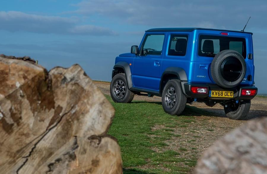 Just like its utilitarian predecessors, the new Jimny gets upright pillars and straight lines. There is no style for style's sake. In other words, no pretensions. The generous black cladding and spare wheel at the back further accentuates this.