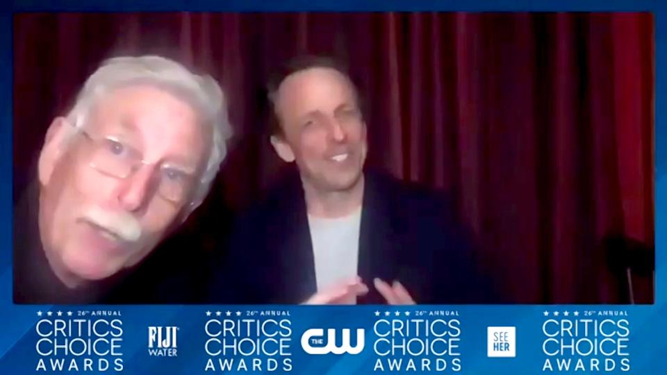 Lawrence Meyers pops into the screen again with son Seth Meyers in the interview room.