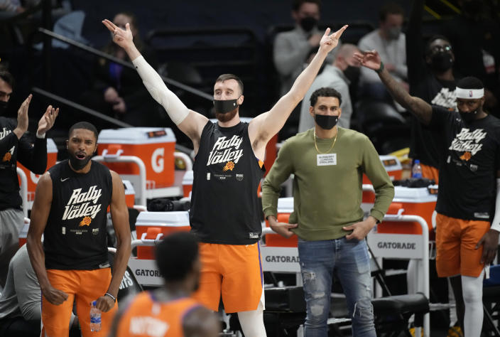 Phoenix Suns react after a basket by Chris Paul against the Denver Nuggets during the second half of Game 3 of an NBA second-round playoff series Friday, June 11, 2021, in Denver. (AP Photo/David Zalubowski)