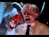 """<p>We all have gigs on our resume that we're ashamed of. They're merely the dues one has to pay to keep working, growing, and keeping the lights on. Here's one of Clooney's. A sequel of sorts to the kitschy 1979 cult cheapie <em>Attack of the Killer Tomatoes</em>, this is a junky, winking spoof of '50s Atomic Age programmers like <em>The Blob</em> in which a town desperately tries to fend off an uprising of giant mutant vegetable-men—or are tomatoes fruit…? Either way, with his period-appropriate mullet and half-smirk that lets you know he's at least in on how god-awful this mess is, Clooney at least seems to be having fun. At least someone is. — <em>CN</em></p><p><a class=""""link rapid-noclick-resp"""" href=""""https://www.amazon.com/Return-Killer-Tomatoes-George-Clooney/dp/B005LF8PXI?tag=syn-yahoo-20&ascsubtag=%5Bartid%7C10054.g.36686692%5Bsrc%7Cyahoo-us"""" rel=""""nofollow noopener"""" target=""""_blank"""" data-ylk=""""slk:Watch Now"""">Watch Now</a></p><p><a href=""""https://www.youtube.com/watch?v=2aIXhmygh3A"""" rel=""""nofollow noopener"""" target=""""_blank"""" data-ylk=""""slk:See the original post on Youtube"""" class=""""link rapid-noclick-resp"""">See the original post on Youtube</a></p>"""