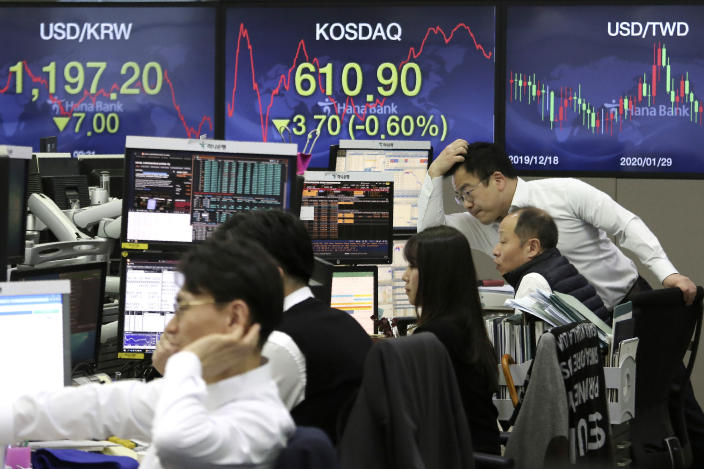 Currency traders watch monitors at the foreign exchange dealing room of the KEB Hana Bank headquarters in Seoul, South Korea, Tuesday, March 10, 2020. Shares edged slightly lower in Tokyo and Seoul after bouncing in and out of negative territory. (AP Photo/Ahn Young-joon)