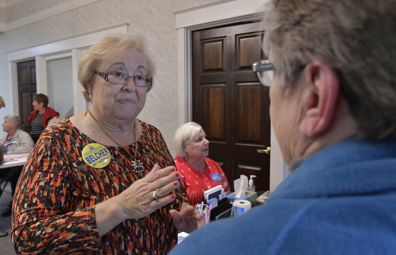 Linda Belcher, left, the Democratic candidate for the Kentucky House of Representatives representing the 49th District speaks with a supporter during a rally, Tuesday, Feb. 13, 2018, in Shepherdsville, Ky. Belcher, a former representative for the district is running in a special election being held Tuesday, to fill the seat that is now vacant following the suicide of the former representative, Dan Johnson, following his suicide in 2017. (AP Photo/Timothy D. Easley)