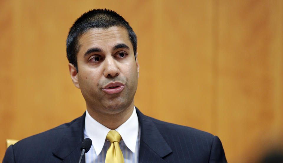 FILE – In this Friday, Aug. 9, 2013, file photo, Federal Communications Commission Commissioner Ajit Pai speaks during an FCC meeting in Washington.(AP Photo/Susan Walsh, File)