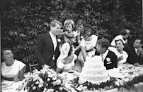 <p>The newlyweds chatted with John's relatives while sitting at the head table.</p>