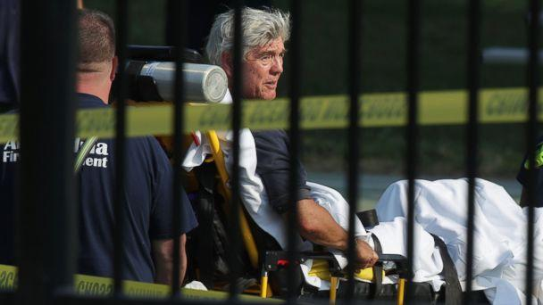 PHOTO: Rep. Roger Williams is wheeled away by emergency medical service personnel from the Eugene Simpson Stadium Park June 14, 2017 in Alexandria, Va., following a shooting at the park. (Alex Wong/Getty Images)