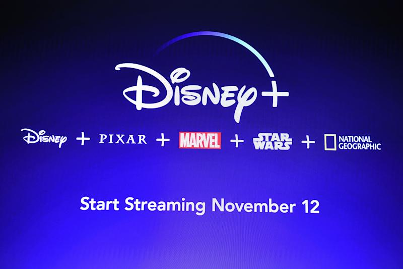 "A screen announcing the Disney+ streaming service is seen at the D23 Expo, billed as the ""largest Disney fan event in the world,"" on August 23, 2019 at the Anaheim Convention Center in Anaheim, California. - Disney Plus will launch on November 12 and will compete with out streaming services such as Netflix, Amazon, HBO Now and soon Apple TV Plus. (Photo by Robyn Beck / AFP) (Photo credit should read ROBYN BECK/AFP/Getty Images)"