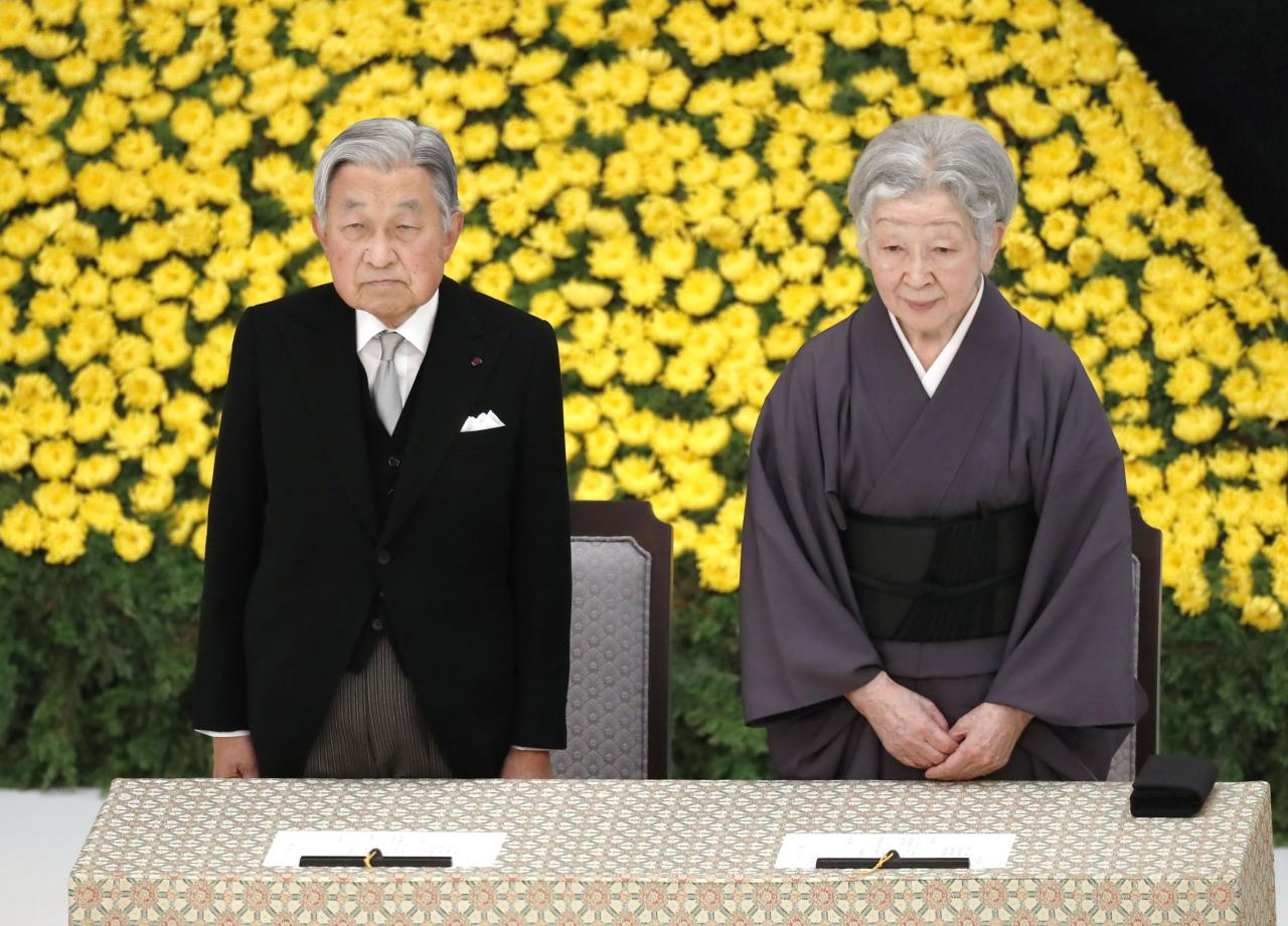 Japanese Emperor Akihito and Empress Michiko, attend a memorial service for the war dead at Nippon Budokan martial arts hall Wednesday, Aug. 15, 2018, in Tokyo. Emperor Akihito has expressed deep remorse over his country's role in World War II as he made his last appearance at a ceremony marking the end of the hostilities. (Hiroko Harima/Kyodo News via AP)