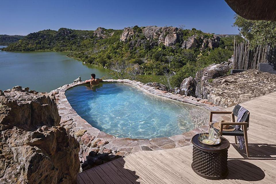 """<p>All eight suites at this super <a href=""""https://singita.com/lodge/singita-pamushana-lodge/"""" rel=""""nofollow noopener"""" target=""""_blank"""" data-ylk=""""slk:exclusive safari lodge"""" class=""""link rapid-noclick-resp"""">exclusive safari lodge</a> have a plunge pool with endless views of the Malilangwe Wildlife Reserve. Chances of us ruining sunset in it by singing Circle of Life from The Lion King? High.</p>"""