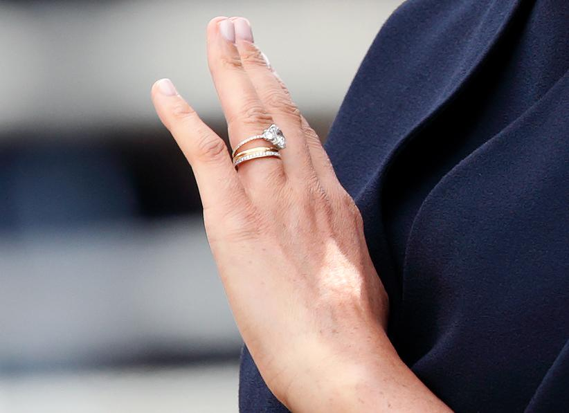 LONDON, UNITED KINGDOM - JUNE 08: (EMBARGOED FOR PUBLICATION IN UK NEWSPAPERS UNTIL 24 HOURS AFTER CREATE DATE AND TIME) Meghan, Duchess of Sussex (ring detail) travels down The Mall in a horse drawn carriage during Trooping The Colour, the Queen's annual birthday parade, on June 8, 2019 in London, England. The annual ceremony involving over 1400 guardsmen and cavalry, is believed to have first been performed during the reign of King Charles II. The parade marks the official birthday of the Sovereign, although the Queen's actual birthday is on April 21st. (Photo by Max Mumby/Indigo/Getty Images)
