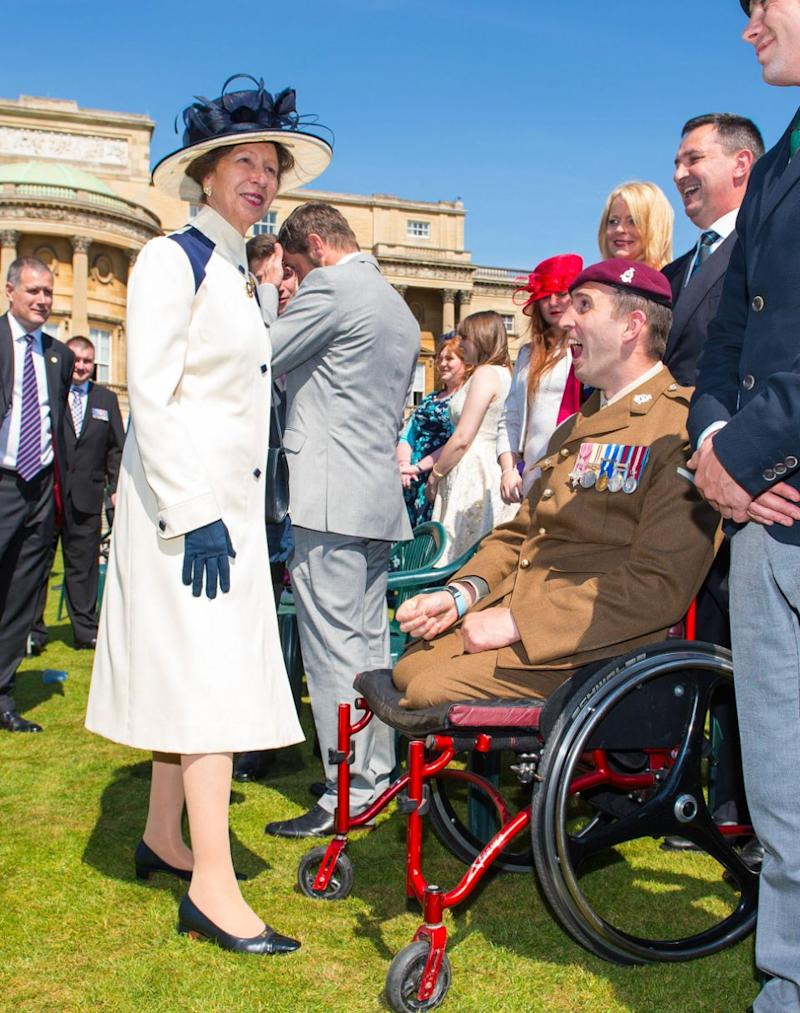 Princess Anne accessorised with a feathered hat at a 2015 garden party at Buckingham Palace. Photo: Getty