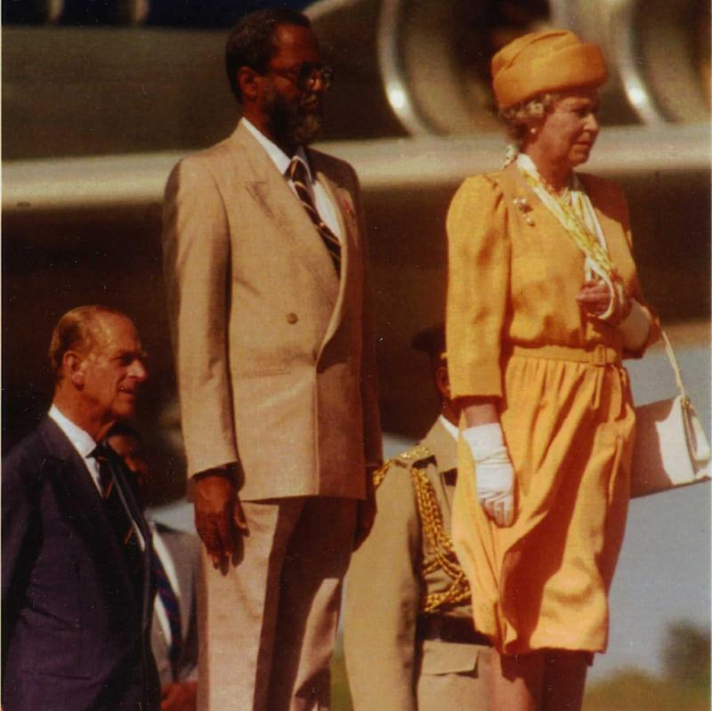 Queen Elizabeth II stands with Colville Norbert Young and her husband Prince Philip during a visit to Belize - Credit: AP