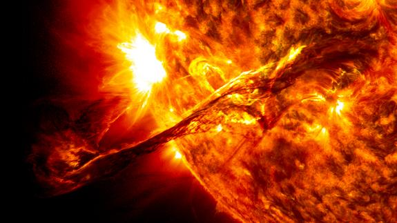 On Aug. 31, 2012, a giant prominence on the sun erupted, sending out particles and a shock wave that traveled near Earth. This event may have been one of the causes of a third radiation belt that appeared around Earth a few days later, a phenom