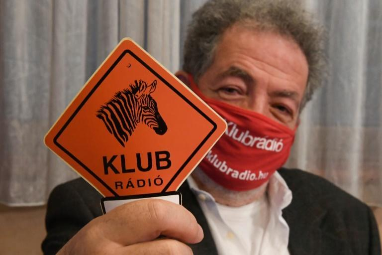Andras Arato, chairman of the independent Hungarian radio station Klubradio, shows its logo as it loses an appeal to stay on the air