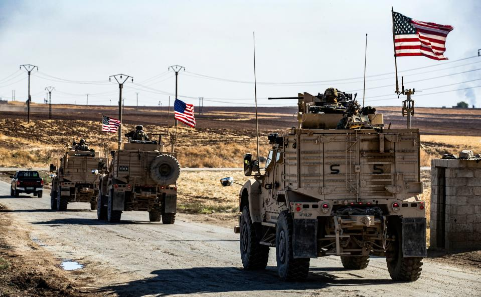 U.S. military armored vehicles in Syria's Hasakeh province in 2019. (Delil Souleiman/AFP via Getty Images)