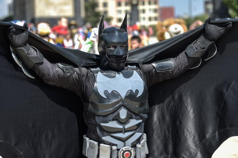 An artist disguised as Batman takes part in a protest to demand Mexican government aid, as they have been unable to work on the streets for the past month due to restrictions to prevent the spread of the novel coronavirus COVID-19 in Mexico City, on April 30, 2020. (Photo by PEDRO PARDO / AFP) (Photo by PEDRO PARDO/AFP via Getty Images)
