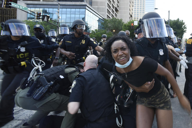 Atlanta Police detain demonstrators protesting, Saturday, May 30, 2020 in Atlanta. The protest started peacefully earlier in the day before demonstrators clashed with police. Demonstrators took to the streets across the country to protest the death of George Floyd, a black man who was killed in police custody in Minneapolis on May 25. (AP Photo/Mike Stewart)