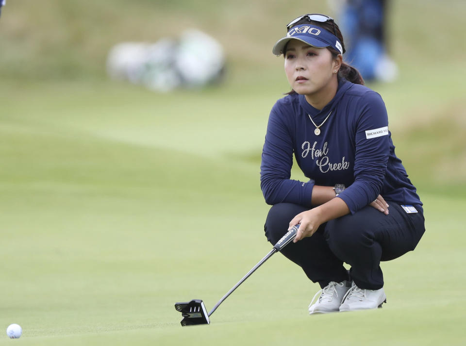 Japan's Serena Aoki rlines up her putt on the 13th green during the second round of the Women's British Open golf championship, in Carnoustie, Scotland, Friday, Aug. 20, 2021. (AP Photo/Scott Heppell)