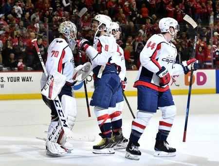 Mar 24, 2019; Washington, DC, USA; Washington Capitals goaltender Braden Holtby (70) and left wing Alex Ovechkin (8) celebrate after defeating the Philadelphia Flyers at Capital One Arena. Mandatory Credit: Brad Mills-USA TODAY Sports