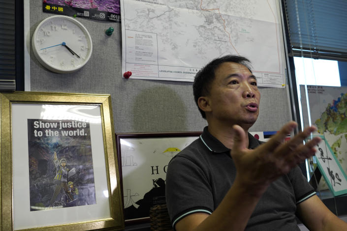 Pro-democracy lawmaker Wu Chi-wai gestures during an interview at his office in Legislative Council in Hong Kong on Nov. 19, 2020. After nearly three decades in politics, the 58-year-old Wu, chairman of Hong Kong's largest pro-democracy party, is stepping down Monday, Nov. 30, 2020. All 15 lawmakers in the pro-democracy camp have decided to resign to protest a Beijing resolution in early November that led to the disqualifications of four of their colleagues. (AP Photo/Vincent Yu)
