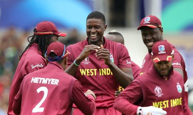 Jason Holder, centre, will consult team-mates over any action (Tim Goode/PA)