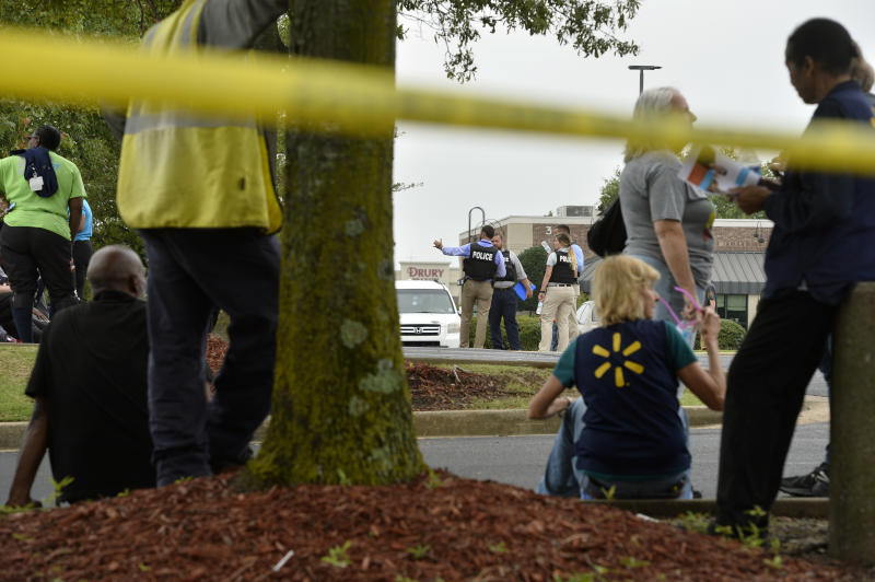 Officers and employees gather in a nearby parking lot after a shooting at a Walmart store Tuesday, July 30, 2019 in Southaven, Miss. (Photo: Brandon Dill/AP)