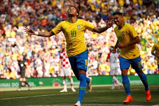 Soccer – International Friendly – Brazil vs Croatia – Anfield, Liverpool, Britain – June 3, 2018 Brazil's Neymar celebrates scoring their first goal with Roberto Firmino (Reuters)