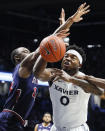 Xavier's Tyrique Jones (0) battles for the ball against St. John's Mustapha Heron, left, in the first half of an NCAA college basketball game, Saturday, March 9, 2019, in Cincinnati. (AP Photo/John Minchillo)